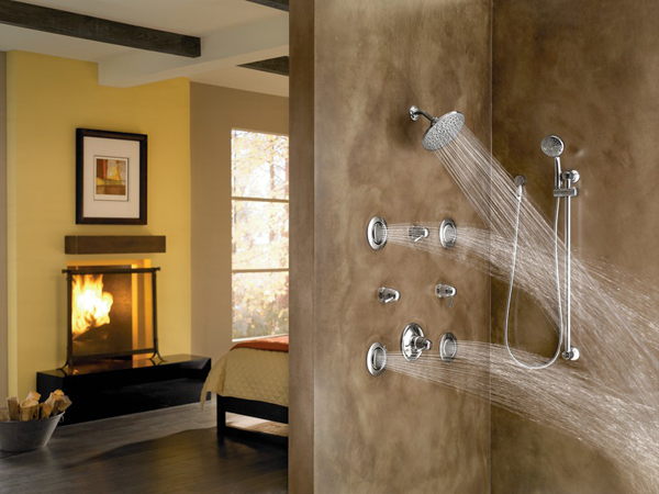 luxury shower with many showerheads and fire place in next room