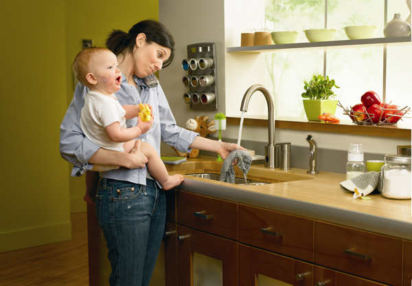 mom and baby at sink in kitchen